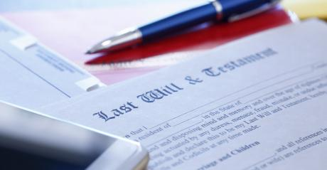 Last Will and Testament with pen on top waiting  to be signed