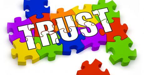 Trust puzzle, 3D jigsaw pieces with text.