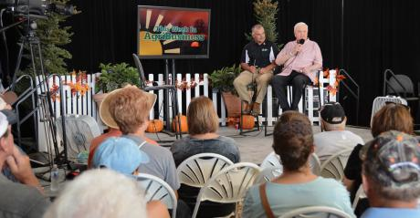 Max Armstrong and Orion Samuelson onstage at Farm Progress Show