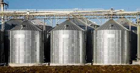 grain bins on a background of blue sky