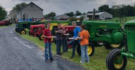 Boys snack at the annual tractor reunion at Andrew Fox's farm, Newmanstown, Pa.