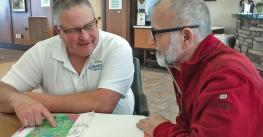 Chuck Bolte consults with a farmer on a nutrient management plan