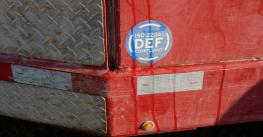 DEF compliance decal on side of truck