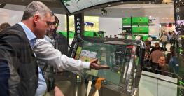 John Deere prototype cab with two large monitors displayed at Agritechnica