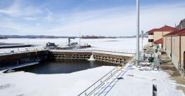 'A lock, used to raise and lower barges, on the frozen Mississippi river.