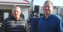 Mike Newland, PERC director of agriculture business development (left), and Cinch Munson, PERC senior vice-president, business development, talked at Husker Harvest Days last year about their organization's partnerships with equipment manufacturers to bri