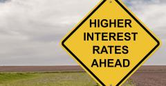 Caution sign with words Higher Interest Rates