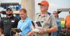 Dennis Bowman operates drone with controller