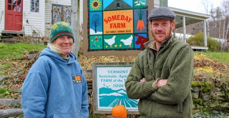 Scout Proft and son Eben stand together outside at Someday Farm in East Dorset, Vt