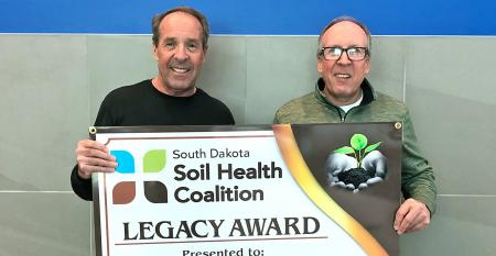 Gene (left) and Craig Stehly the SD Soil Health Coalition's Legacy Award