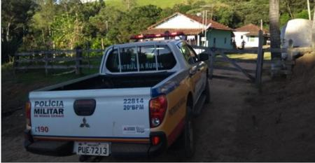 Photo of police truck at farm gate