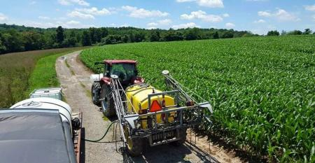 Close-up view of sprayer in corn field