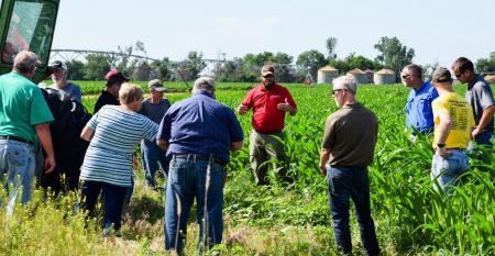 farmer discusing Harrison County pest resistance management  at field days