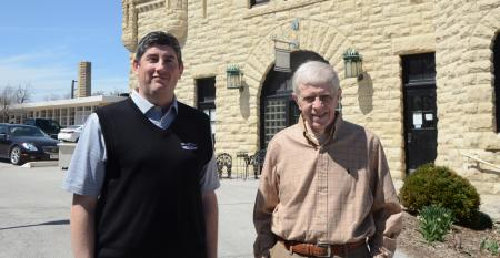 John Dechant (left) and Bob Mundy in front of the Legacy Preservation office at the Carriage House of Joslyn Castle in Omaha.