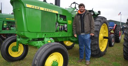 Andy Rayl with his family's 1965 John Deere 3020 Diesel tractor