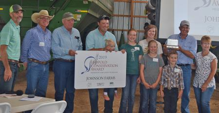 group shot of presenters and Johnson Farms family, recipients of S.D. Leopold Conservation Award