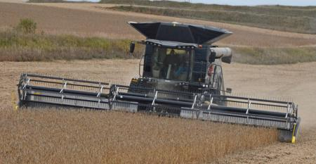 Agco combine in soybean field