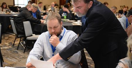CPA and boot camp instructor Paul Neiffer offers advice to an attendee at the 2019 Ag Finance Boot Camp.