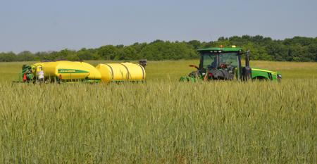 John Deere tractor and planter planting into green cover crop