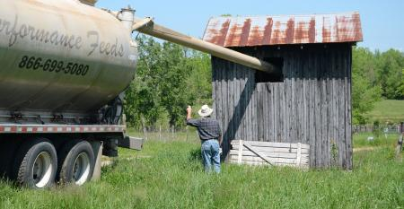 Farmer getting a delivery of supplement