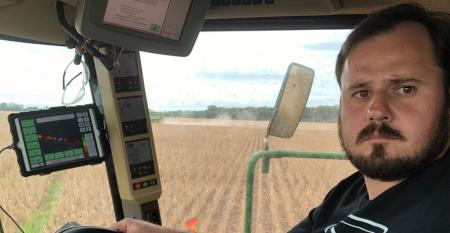 close up on man in combine cab
