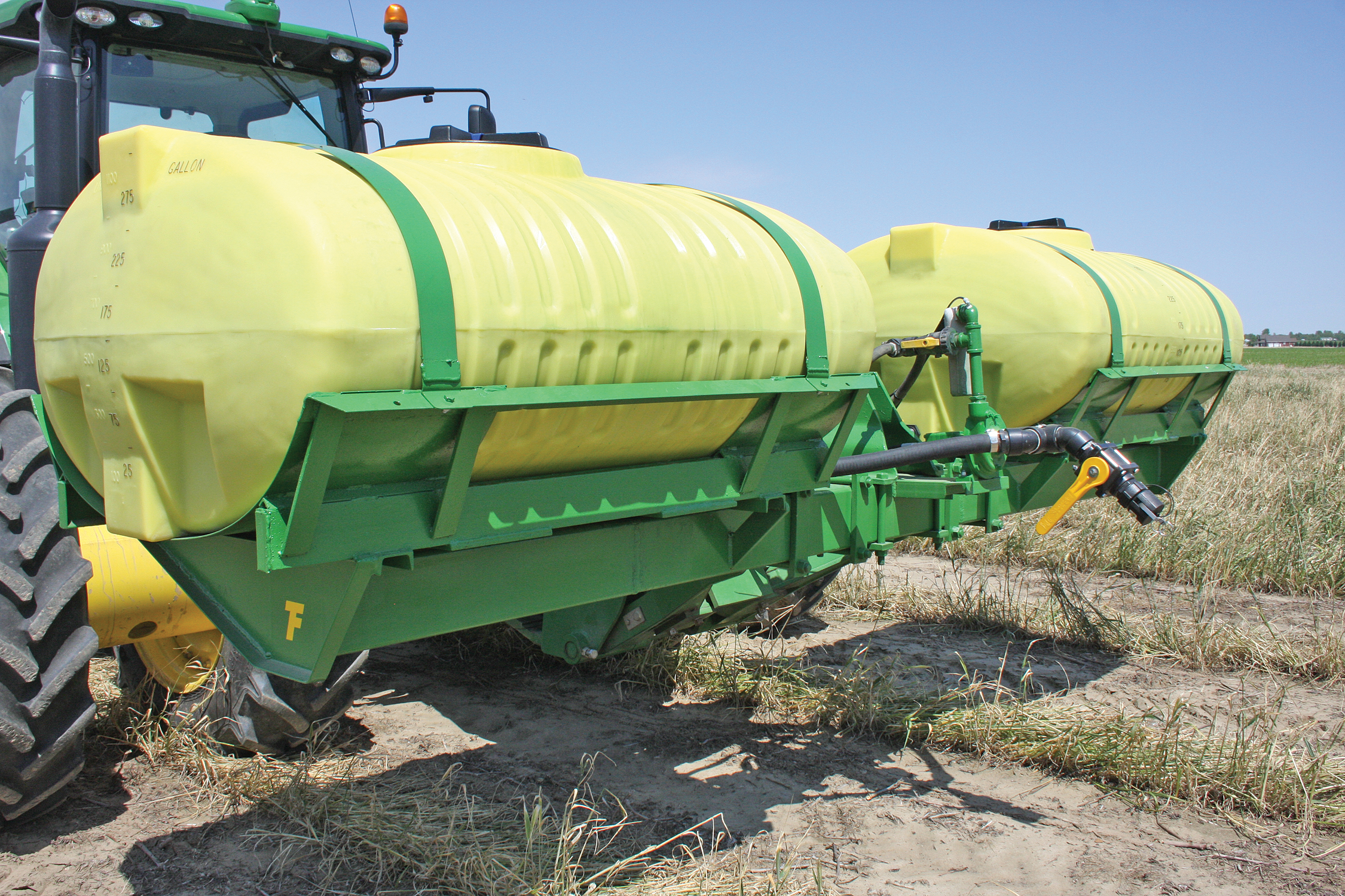 PATRICK TURNAGE'S front-mounted tanks cost less than half the price of side-mounted tanks.